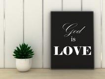Faith religion concept. God is Love quotation in frame Stock Photos