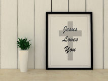 Faith religion concept. Jesus loves you quotation in frame Stock Photo