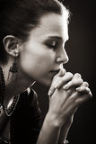 Faith and religion - prayer of woman. Faith and religion - spiritual woman praying in darkness Royalty Free Stock Photos