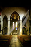 Faith and religiosity. Interior of old church in Dominican monastery in Dubrovnik, dark interior with rays of light shining through the window Royalty Free Stock Images