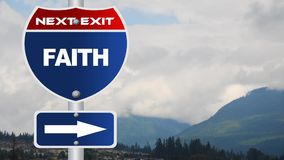 Faith road sign with flowing clouds stock video