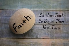 Faith Rock on Background with Faith Quote. Faith Rock with Quote- Let Your Faith Be Bigger Than Your Fears royalty free stock image