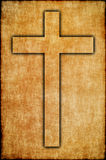 Faith symbol. Cross on ols paper. Stock Image