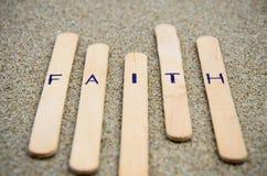 Faith. Text in FAITH word put on the sand Royalty Free Stock Photography