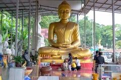The faith. THAMAI, CHANTHABURI, THAILAND - JULY 31 : Unidentified tourists are worshiping the big buddha image on July 31, 2015 at Wat Khaosukim, Thamai Royalty Free Stock Image