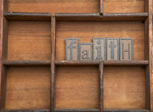Faith in wooden letters. Royalty Free Stock Images