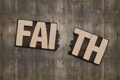 FAITH word with broken board Royalty Free Stock Photos