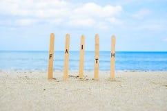 Faith. Word faith pin on the sand beach Royalty Free Stock Images