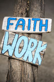 Faith and work wooden signs on tree trunk in Mancora, Peru Stock Image