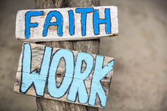 Faith and work wooden signs on tree trunk in Mancora, Peru Royalty Free Stock Photo