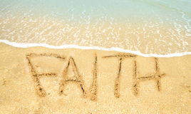 Faith written in sand. Faith written on the shoreline at the ocean Royalty Free Stock Images