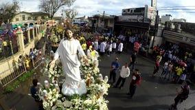 Faithful Catholics gather around statue before religious procession. San Pablo City, Laguna, Philippines - December 5, 2017: Faithful Catholics gather around stock footage