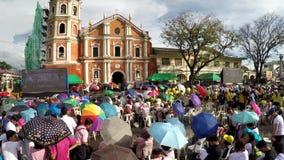 Faithful Catholics gather at church square celebrating jubilee. San Pablo City, Laguna, Philippines - December 5, 2017: Faithful Catholics gather at church stock video footage