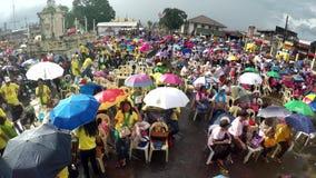 Faithful Catholics gather at church square celebrating jubilee. San Pablo City, Laguna, Philippines - December 5, 2017: Faithful Catholics gather at church stock footage