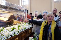 The faithful gather to look at the relics of St. Leopold Mandić in the Church of Saint Leopold Mandic, Zagreb. The faithful gather to look at the relics of stock images