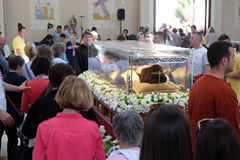 The faithful gather to look at the relics of St. Leopold Mandić in the Church of Saint Leopold Mandic, Zagreb. The faithful gather to look at the relics of stock image