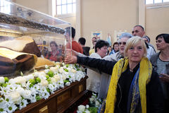 The faithful gather to look at the relics of St. Leopold Mandić in the Church of Saint Leopold Mandic, Zagreb. The faithful gather to look at the relics of royalty free stock photos