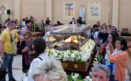 The faithful gather to look at the relics of St. Leopold Mandić in the Church of Saint Leopold Mandic, Zagreb. The faithful gather to look at the relics of royalty free stock photo