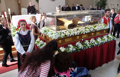 The faithful gather to look at the relics of St. Leopold Mandić in the Church of Saint Leopold Mandic, Zagreb. The faithful gather to look at the relics of stock photography