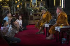 Faithful and Monks in the temple in Bangkok. stock images