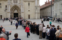 The faithful waiting in line in front of the cathedral to see the body of St. Leopold Mandic, Zagreb Stock Image