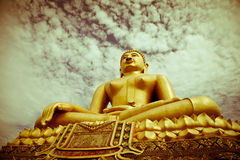 Faithfully. Buddha statue in the Thai temple Stock Photography