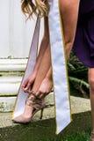 Faixa da menina da graduação imagens de stock