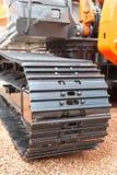 Faixa de lagarta cinzenta e preta do metall do escavador Foto de Stock Royalty Free