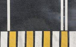 Faixa de travessia da zebra em um fundo da estrada asfaltada Fotografia de Stock Royalty Free