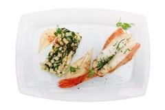 Faixa do luciano e aipo fritado isolados no branco Imagens de Stock