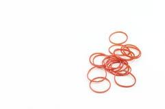 Faixa plástica vermelha no fundo branco Fotografia de Stock Royalty Free