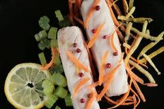 Faixas dos bacalhaus com vegetais Fotos de Stock