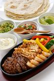 Fajitas. Sizzling beef chicken and shrimp fajitas, mexican cuisine, tex-mex cuisine Royalty Free Stock Photo