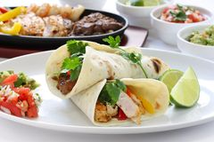 Fajitas. Sizzling beef chicken and shrimp fajitas, mexican cuisine, tex-mex cuisine Royalty Free Stock Photos