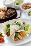 Fajitas. Sizzling beef chicken and shrimp fajitas, mexican cuisine, tex-mex cuisine Stock Photography