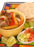 Fajitas. With a variety of condiments and limes Royalty Free Stock Photography