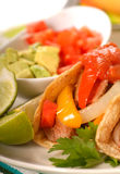 Fajitas. With a variety of condiments and limes Stock Image