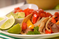Fajitas. With a variety of condiments and limes Royalty Free Stock Images