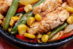 Fajitas with chicken. On a frying pan. Latin cuisine Stock Photo