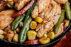 Fajitas with chicken. On a frying pan. Latin cuisine Stock Image