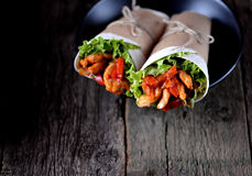 Fajitas with chicken, pepper, onion in a spicy tomato sauce, served in a tortilla. stock image