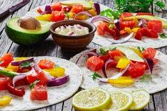 Fajitas with chunks of smoked salmon, close-up Stock Image