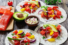 Fajitas with chunks of smoked salmon, close-up Royalty Free Stock Images