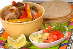 Fajitas with condiments Stock Images