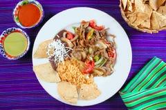 Fajitas de res beef fajita Mexican food. Nachos and chili sauce Stock Photography