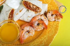 Fajitas dinner with shrimp. Chicken fajitas with shrimp and butter sauce stock photos
