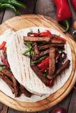 Fajitas with grilled vegetable. Fajitas, mexican beef with grilled vegetable and tortillas Stock Photos
