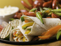 Fajitas on iron cooking plate Royalty Free Stock Photos