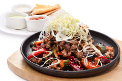 Fajitas: meat with vegetables. Traditional mexican beef fajitas on white background Stock Images