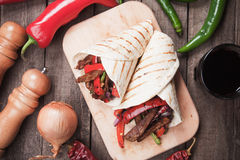 Fajitas, mexican beef stripes in tortilla wrap. Mexican fajitas, spicy beef and vegetable in tortilla wrap Royalty Free Stock Photo